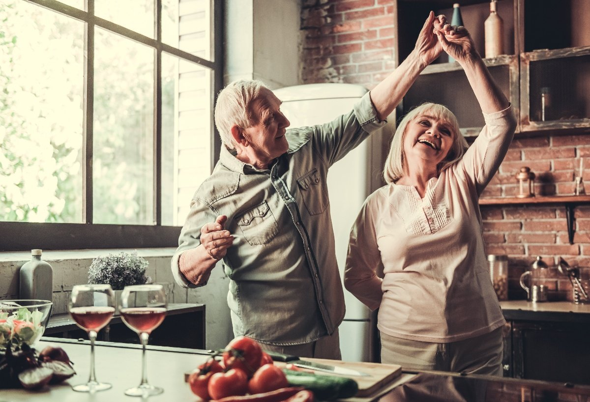 older adults dancing in kitchen