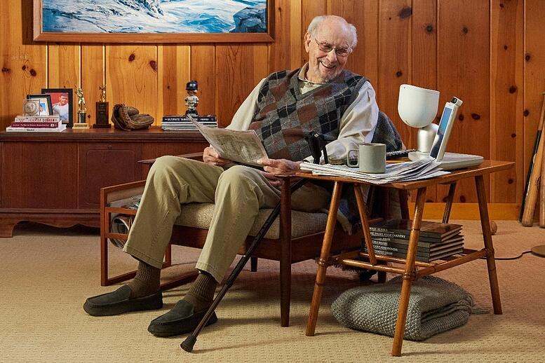 senior man using ElliQ
