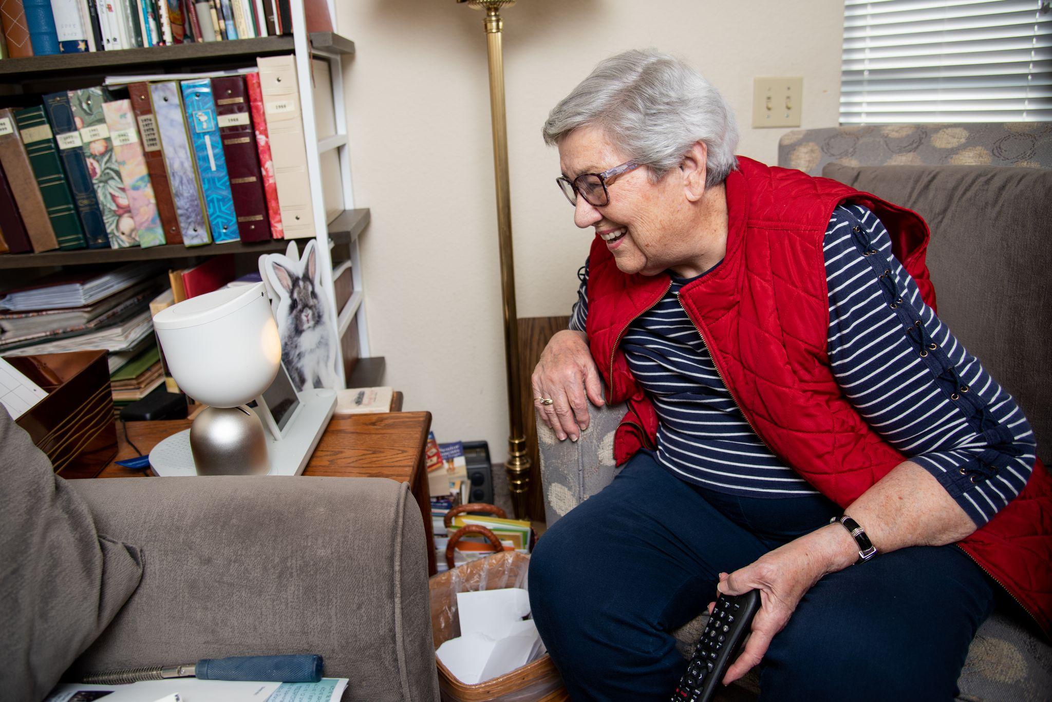 older adult woman using ElliQ