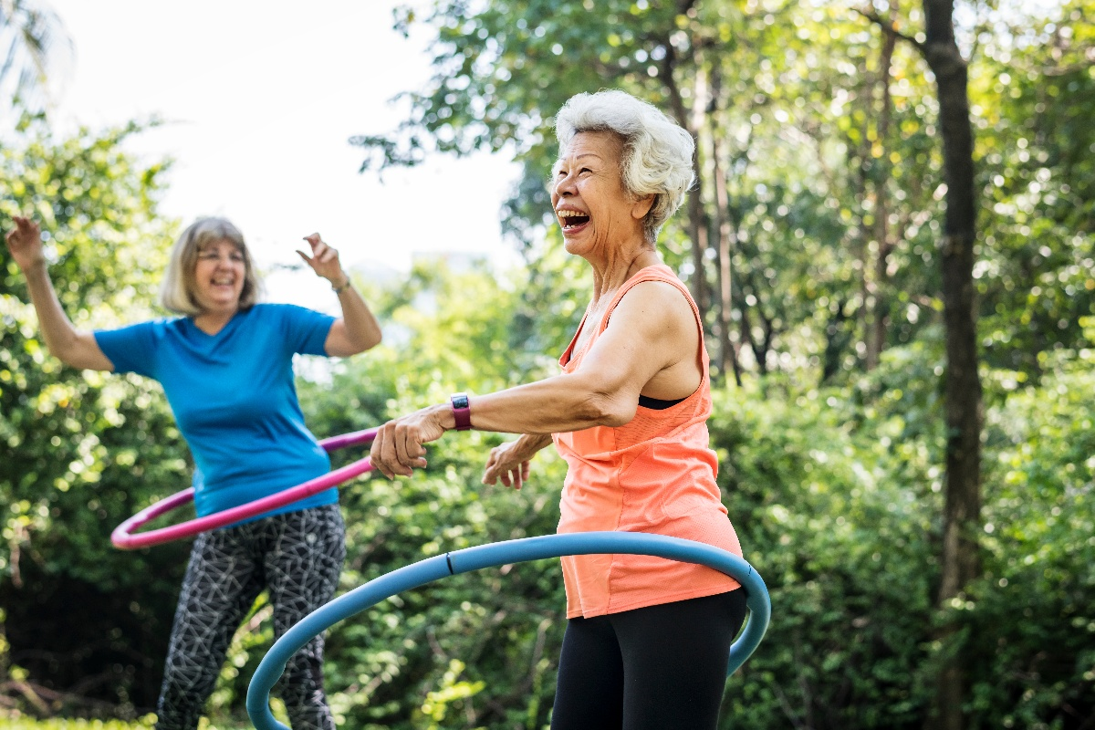 senior women exercising in park