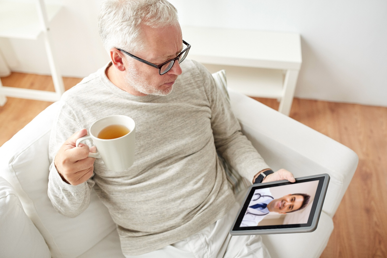 senior man using telehealth technology