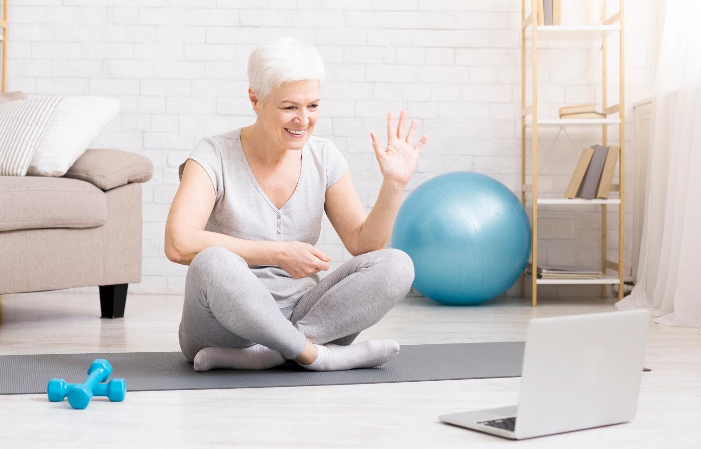 senior woman exercises online