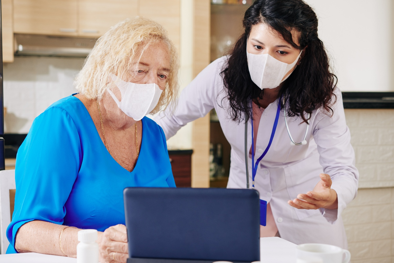 provider helping senior woman use digital health platform