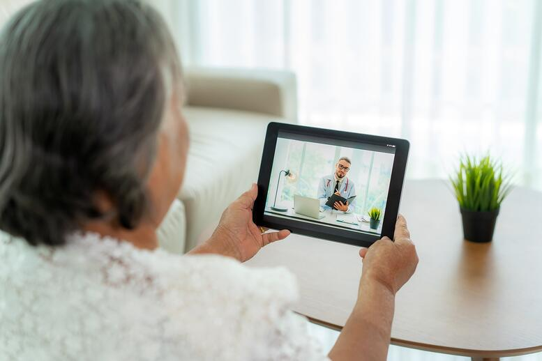 older adult woman virtually visiting with doctor