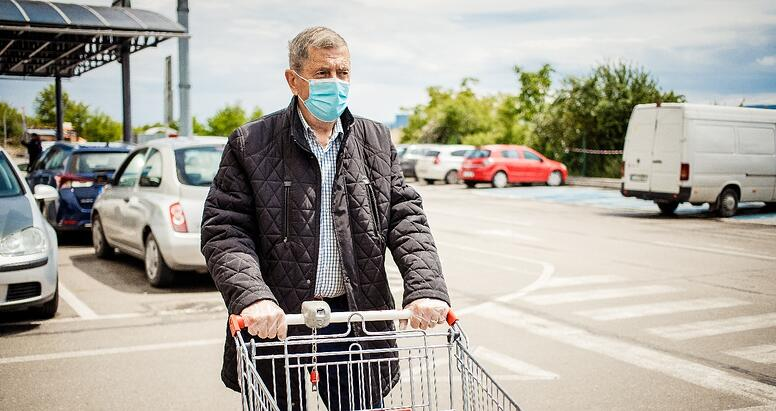 older adult man going to grocery store