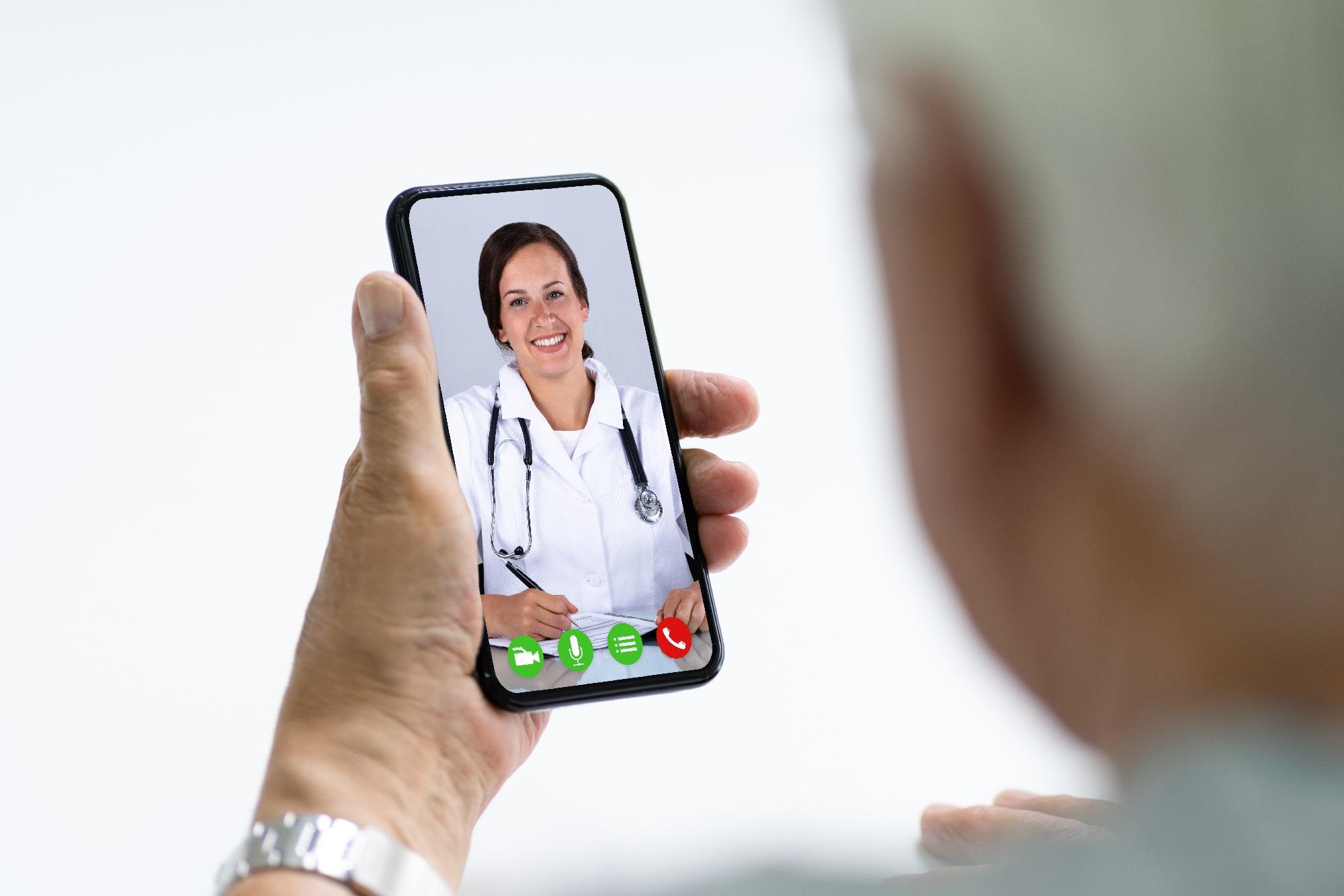 senior man visiting doctor via telehealth on smartphone