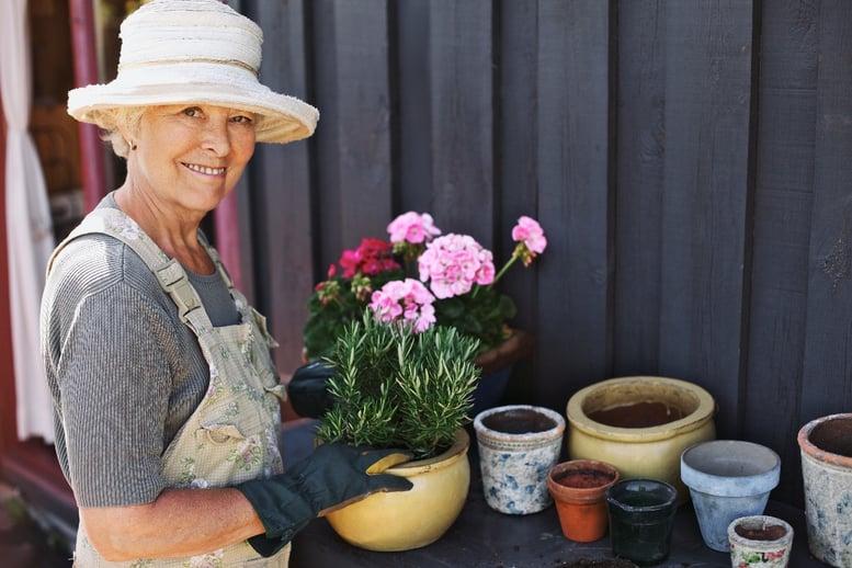 older adult woman in garden