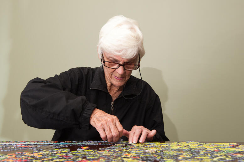 senior woman doing puzzle