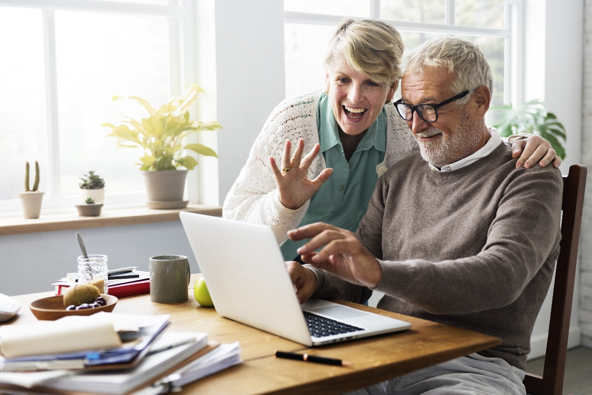 older adult couple using computer