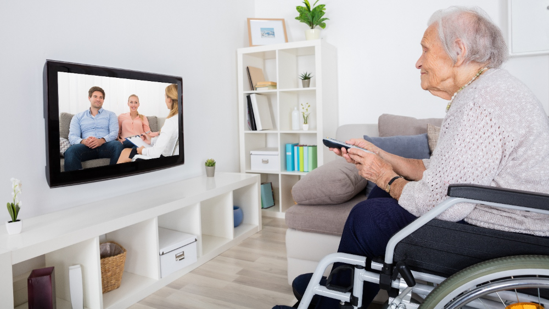 elderly woman watching tv