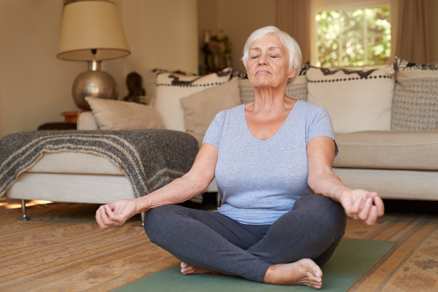 older adult woman meditating