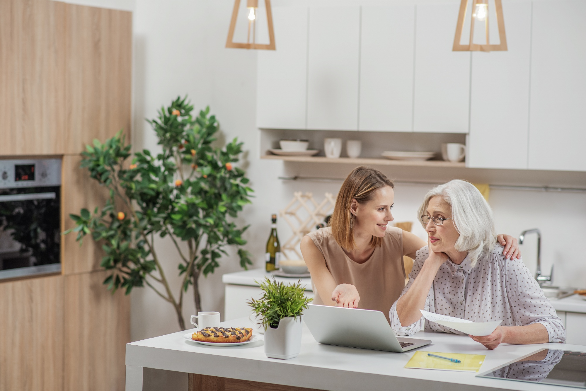 daughter talking things through with elderly mother