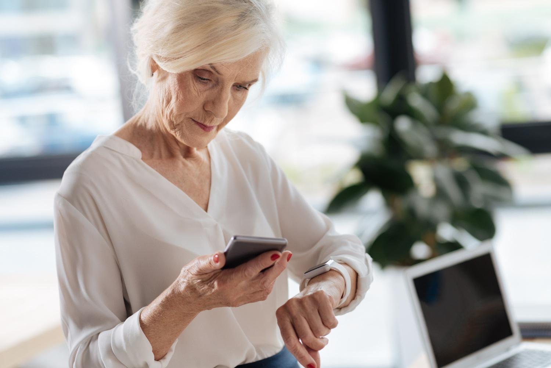 senior woman using wearble health gadgets