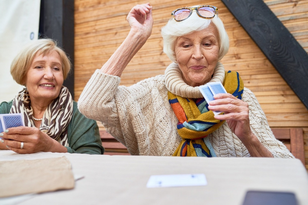 senior women playing card games