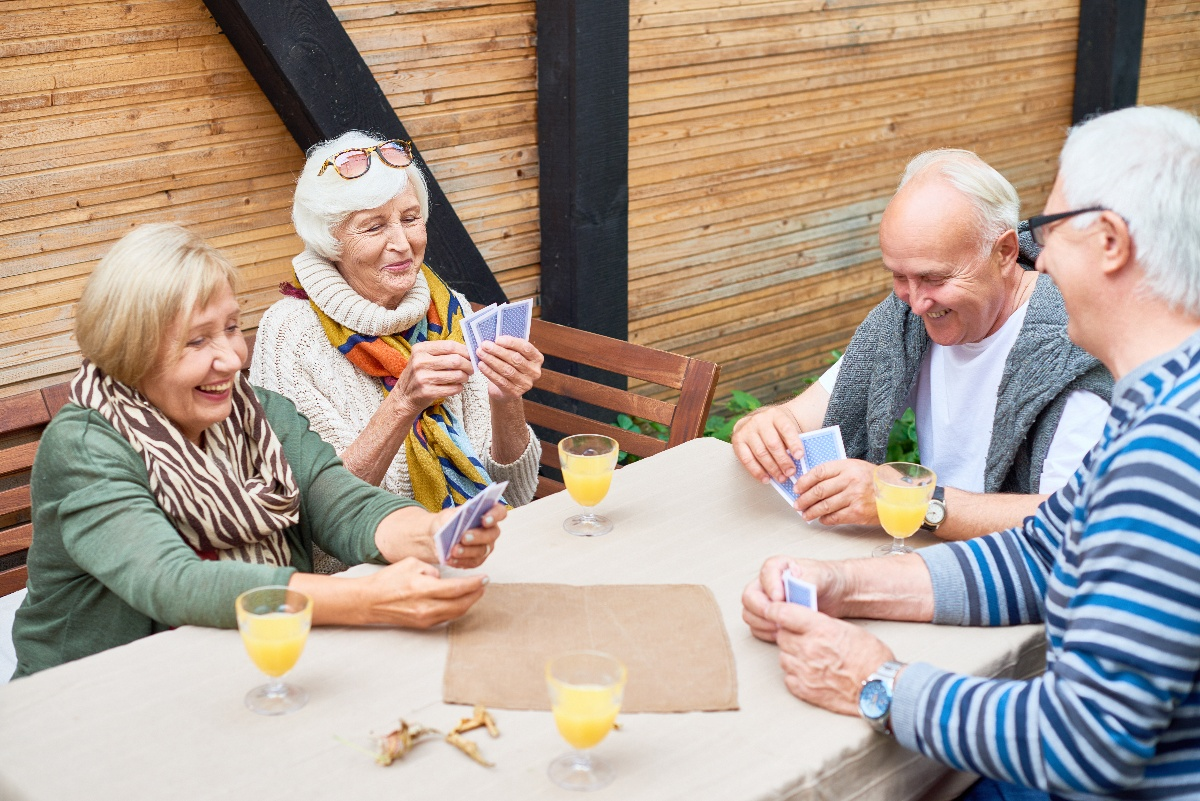 group of seniors playing cards together