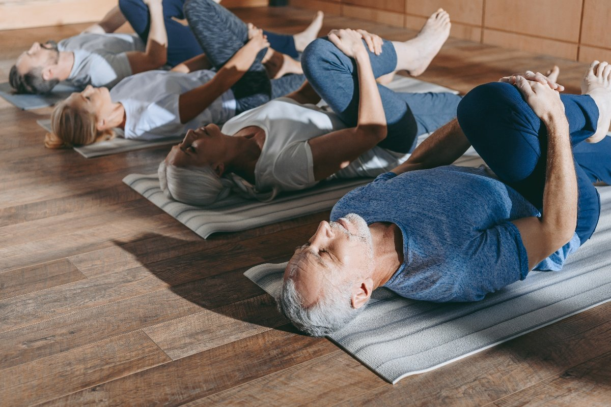 group of older adults stretching